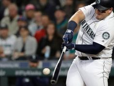 Mariners belt 3 homers, beat Athletics 4-3