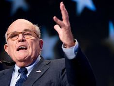 Giuliani walks back AT&T merger comments, says Mueller talks will have to wait