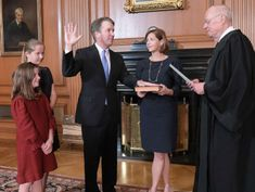 Brett Kavanaugh sworn in as Supreme Court justice amid protests