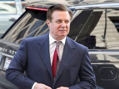 Paul Manafort arrives at court hearing about sentencing date in a wheelchair