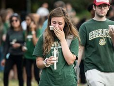 UNCC shooting suspect due in court as shocked students come together in grief