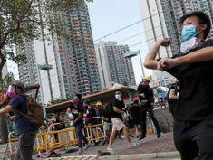 Hong Kong police fire tear gas as strikes paralyze city