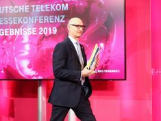 U.S. merger within reach, D.Telekom CEO goes on offensive