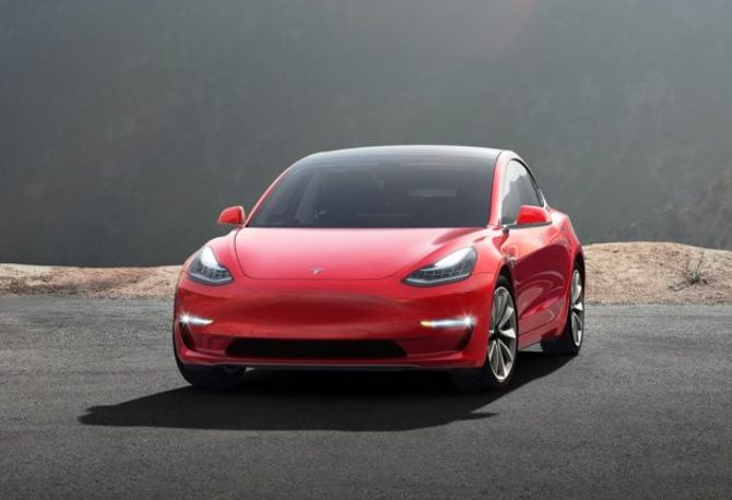 Tesla starts selling $35,000 Model 3 electric cars and shifts to online-only sales
